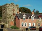 Strangford castle is a simple 16th century Tower House built to control ships entering the lough