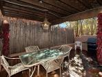 Back patio, downstairs with BBQ grill and outdoor dining table