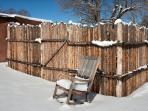 Coyote fencing around hot tub