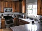 I love my kitchen.  Very good cookware and knives, plenty of dishes and glasses, granite counters