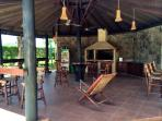 The custom Argentinian style BBQ is housed in the covered gazebo w/ tons of seating to relax & enjoy