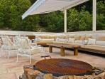 fire-pit at edge of pool deck