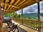 Relax on the huge lower deck with large hot tub, rockers, swing and hammock