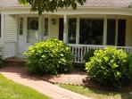 Lovely front entry way and small front porch.