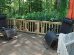 Shady driveway side deck with anti gravity chairs, umbrella, deck chairs, etc.