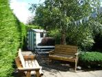 Private, sunny  courtyard garden with seating area, picnic bench and beach hut playhouse...