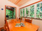 Cottage dining area is spacious and has forest views.