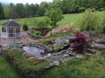 View from  master bedroom deck of koi pond and waterfall