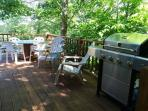 The back deck enjoys the shade of many trees.