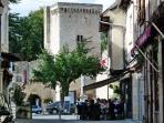 The Cafe de Paris in front of the old castle