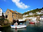 Take a boat trip out to sea from the harbour at Polperro