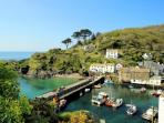 Walk the coastal path and look down onto the harbour at Polperro