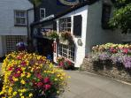 While away an hour or two at the quaint Model Village and Land of Legend, Polperro