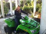 Daughter Alice on 4 wheel drive Arctic Cat one of two ATVs used for transport around the island.