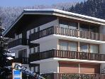 Le Plein Soleil in winter (entire top floor), ski bus stop directly ouside
