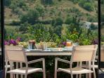 Spanish lunch overlooking the pool with views to the mountains and local vegetable plots/gardens