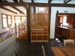 Beautiful Asian screen w/ stairs leading to upstairs bedroom