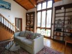 Library w/ beautiful craftsman bookshelves and floor-to-ceiling windows