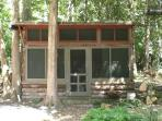 The separate cabin on the property adds cozy summer sleeping (not rented separately).