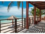 Private shade deck and beach with palapas