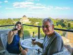 My wife and father enjoy a red on the balcony.