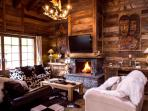 Spacious sitting room of Chalet Alouette with wonderful log fire