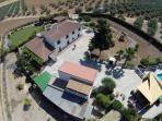 Aerial view of the main house on left, pool and bar on the right and casita with balcony in front