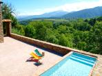 Patio and pool, with views to the forest and the Tossa d'Alp (2.537m)