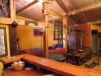 Fully equipped rustic kitchen opens onto the lounge.  Entrance to corner room can be seen on RHS.