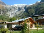 The road ends at the chalet with Le Tour Glacier seeming to hang over the chalet