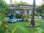 Sunbathe in the private tropical garden