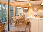Fully Equipped Kitchen And Dining Area That Seats Four