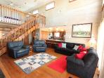 Living Room with beautiful wood accents Fireplace Deck Access Stunning views