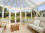 The sun-trap conservatory is a lovely peaceful space to admire the garden