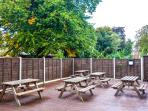 Rear, fully decked garden. 5 picnic benches and a gas bbq make this an ideal area for entertaining!