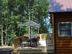 Rear deck w/grill, dining space, mountain views, and hot tub!