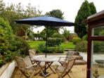 Sunny Patio with table and chairs.  Barbecue area