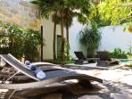 Relax in the courtyard on our sunbeds