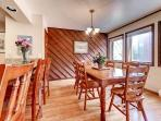 6 person dining table, with additional seating at the breakfast bar.