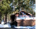 Ski Tahoe North Cabin set among pine trees and huge glacial boulders with panoramic Donner lake view