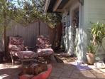 Entrance, patio, cozy chaise lounge chairs for sun or shade.