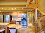 back behind kitchen full bath with washer/dryer/track lighting lightens your complete kitchen