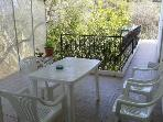 PaxosThea - Dining table in the balcony
