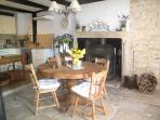Spacious dinning area with large wood burner and flagstone floors.