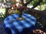 Table on deck under the cherry tree