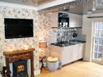 Glittering micro kitchen, roaring fireplace & vintage crockery