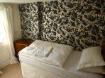 Comfortable 5th Bedroom with Laura Ashley Wall Paper