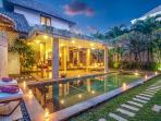 The pool and garden area are beautifully lit at night at Villa Malou.