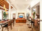 Dining, living and fully equipped kitchen area at Villa Malou.