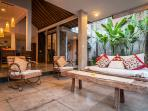 Lounge area with antique chairs at Villa Malou.